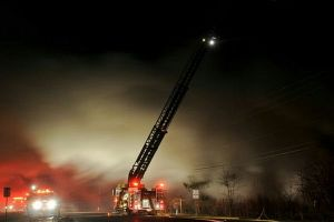 Ladder 58 in operation at night.