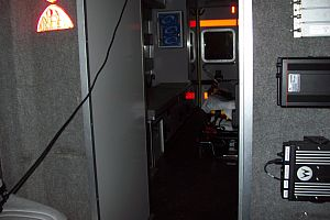 Inside view of patient treatment area from Medic Unit driver's compartment.
